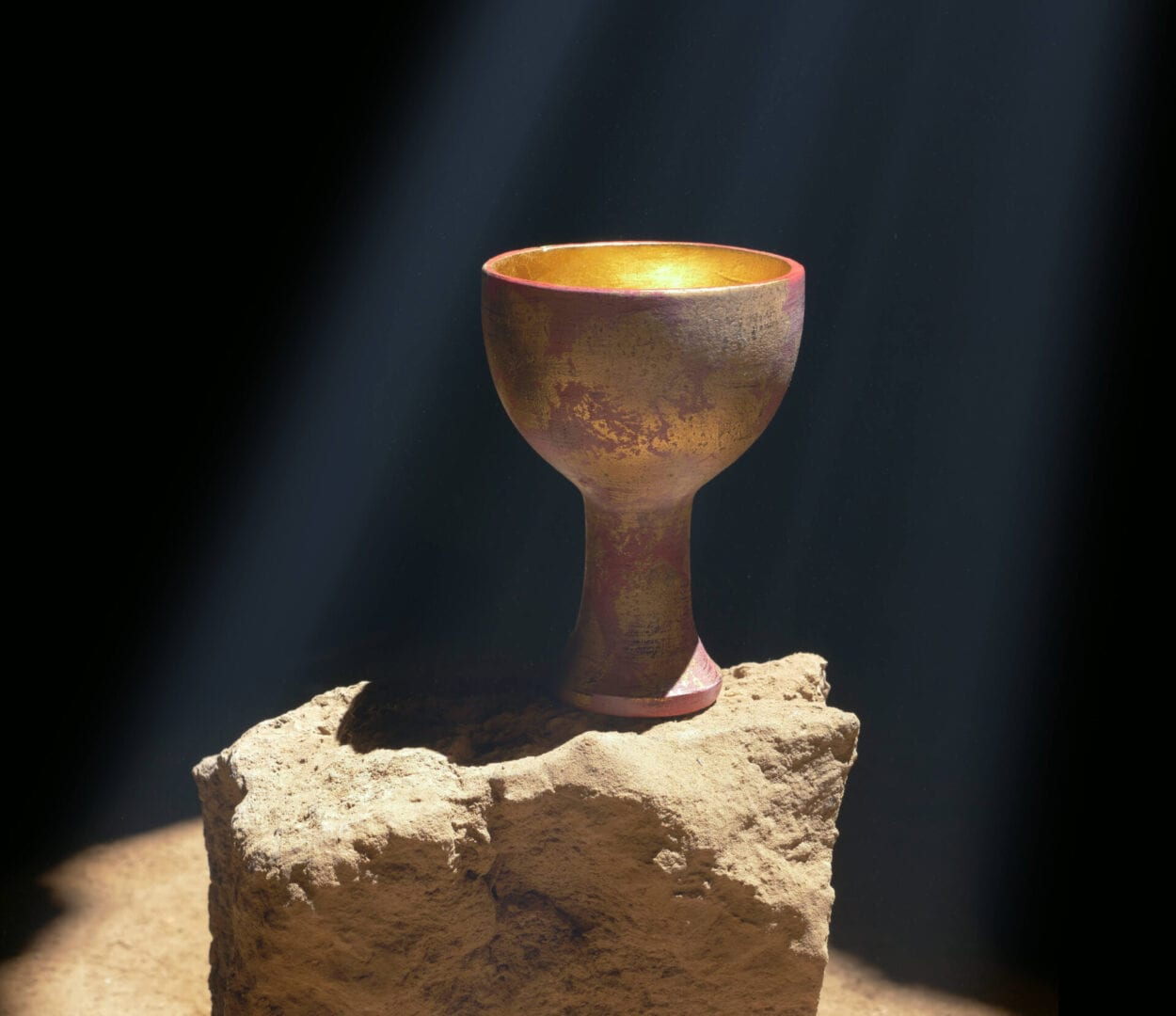 holy grail light up and perched on rock