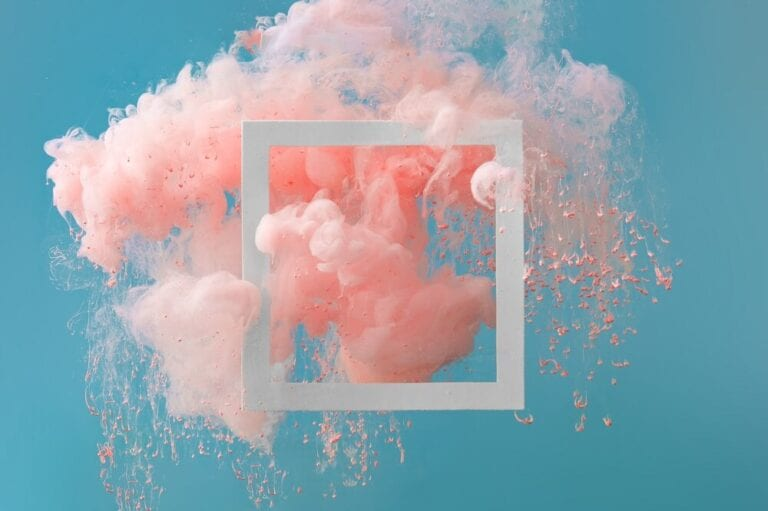 pink cloud bursting on blue background