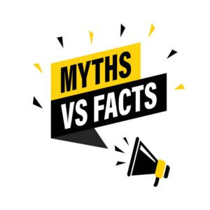 Male hand holding megaphone with myths vs facts speech bubble