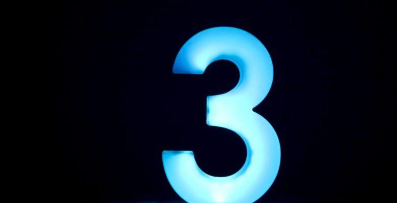 number 3 illuminated in blue