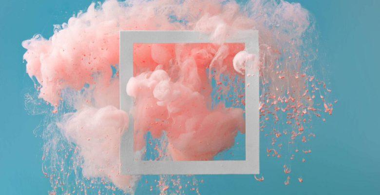 pink cloud bursting blue background