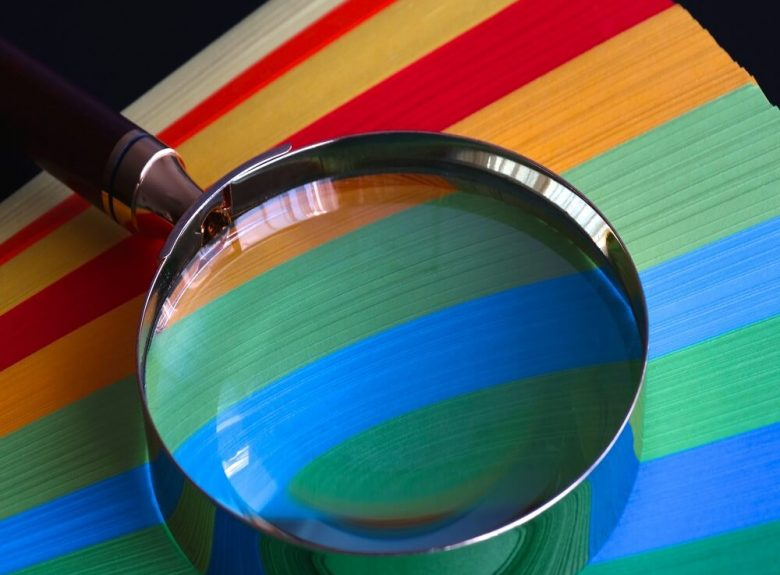 Brown handle magnifying glass inspecting colours