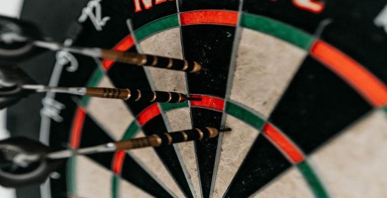 Three darts in dartboard