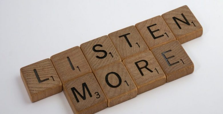 Brown wooden blocks with text listen more