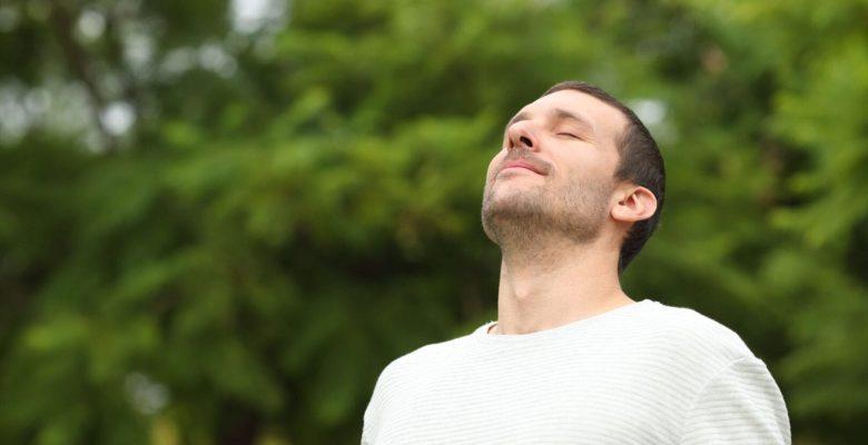 man breathing outdoors