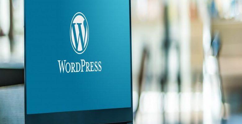 WordPress logo displayed on laptop
