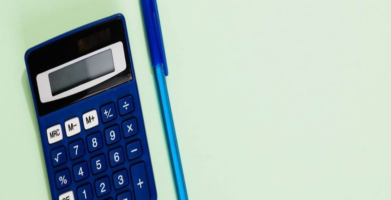 blue calculator and blue pen