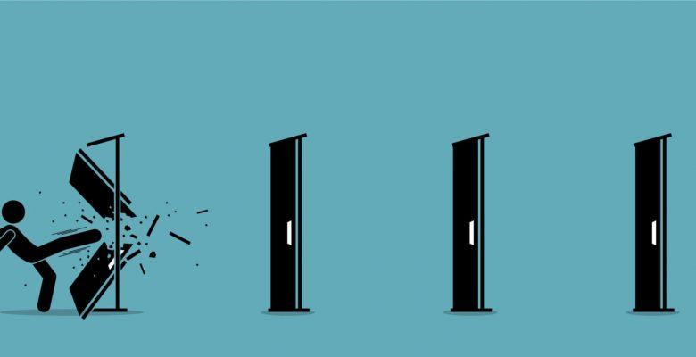 man kicking door with force
