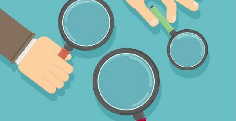 three hands holding different size magnifying glasses surface