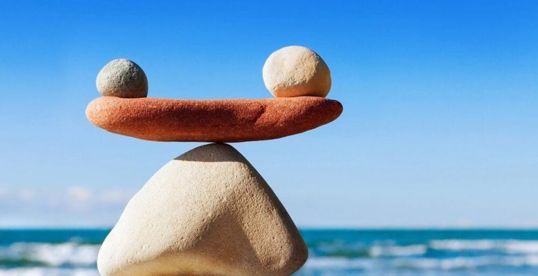 zen principle displayed with balanced rocks overlooking ocean