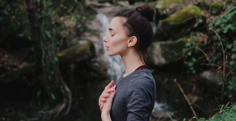 woman practicing breathing in nature