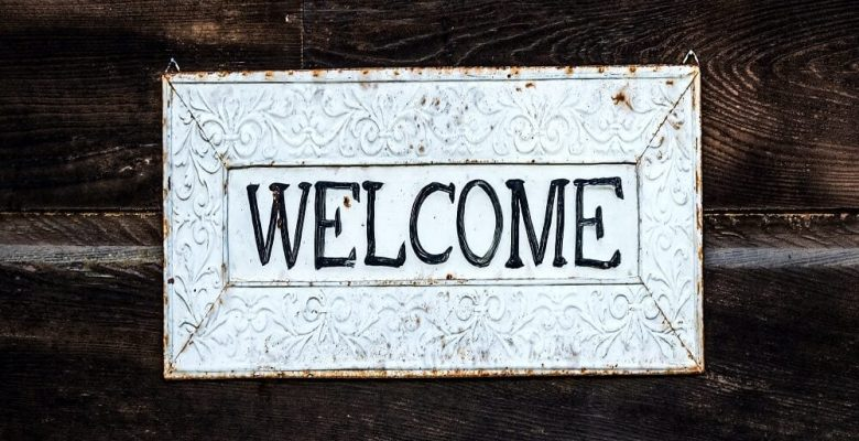 Black and white wooden welcome signage