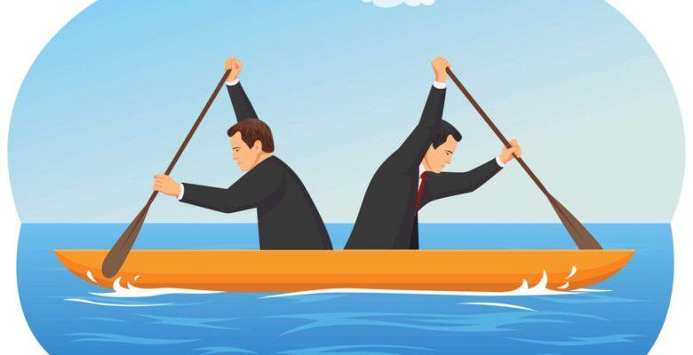 two men in canoe rowing opposite direction