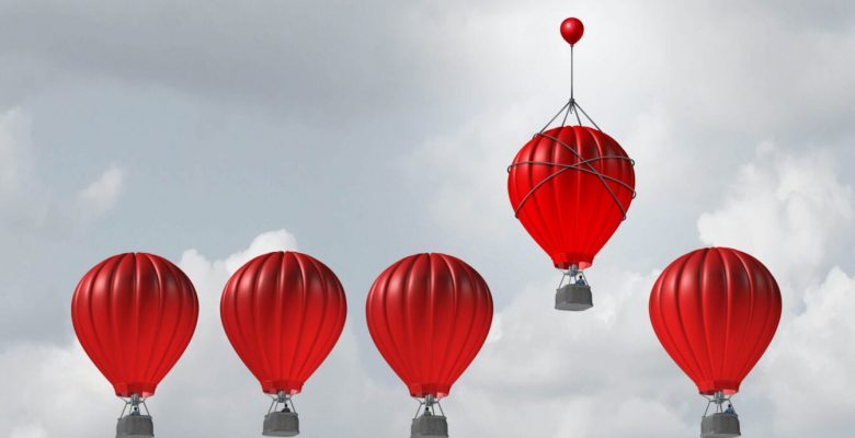 one red balloon flying above other four