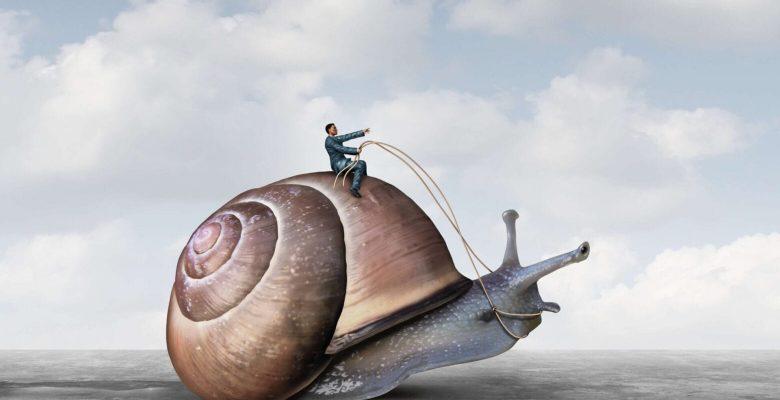 businessman riding large snail