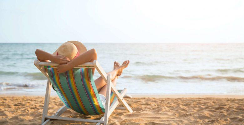 woman relaxing beach chair at beach