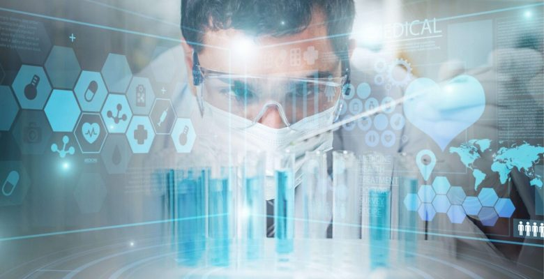 scientist viewing test tubes