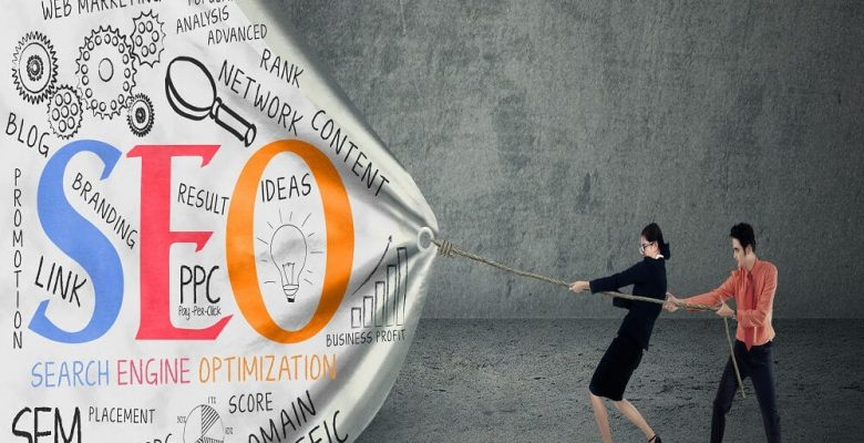 businessman and businesswoman pulling seo banner