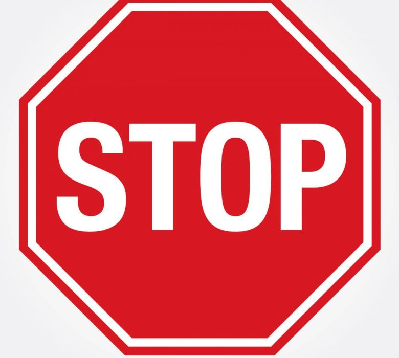 red and white stop sign