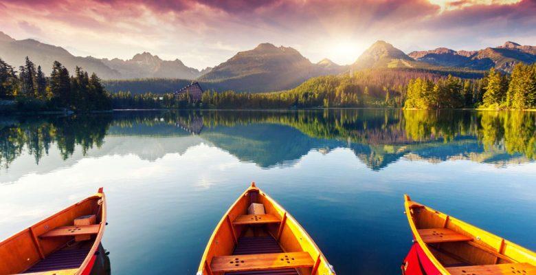 three empty canoes on stunning lake