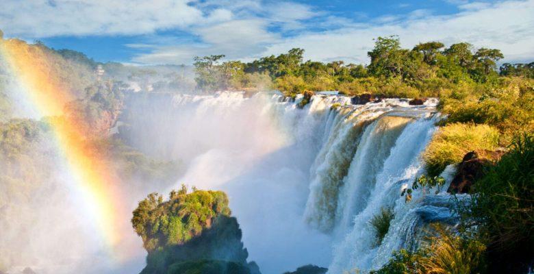 stunning waterfall with rainbow