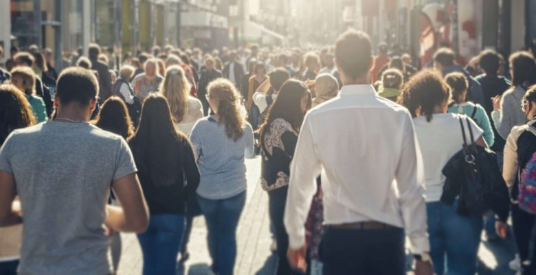 crowd of people walking city