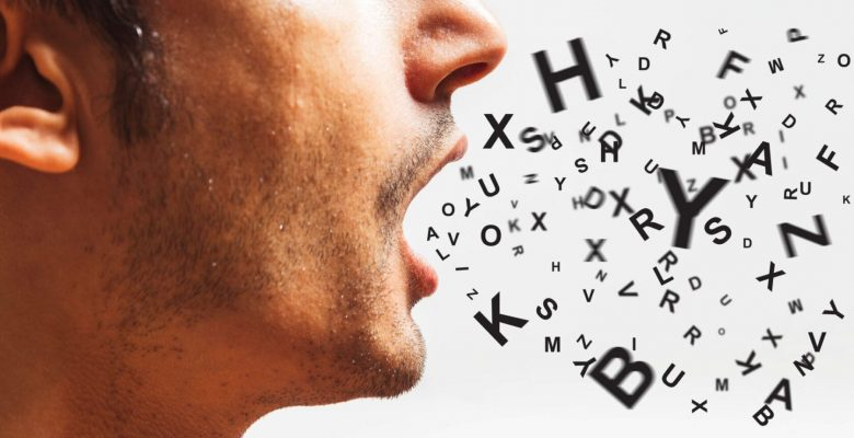 man inhaling letters of alphabet