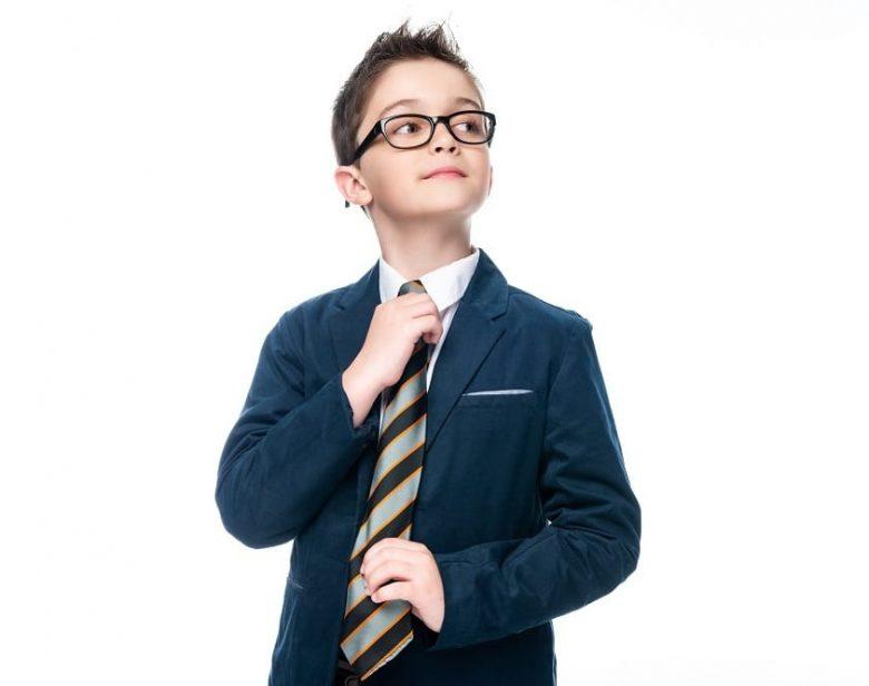 young school boy adjusting tie
